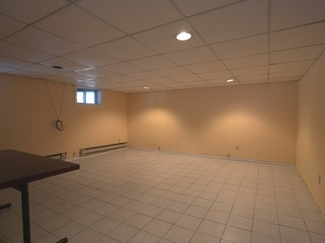 Finished basement with tiled floors